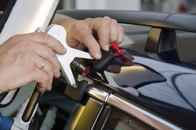What Should A Minor Dent Repair Cost At An Auto Body Paint Shop?